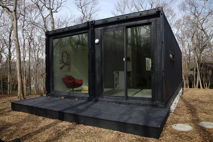 Black storgae container home built as a cheap housing alternative