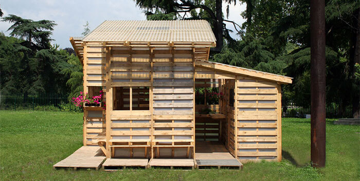 Different style of home built out of free pallets as an extra accommodation space