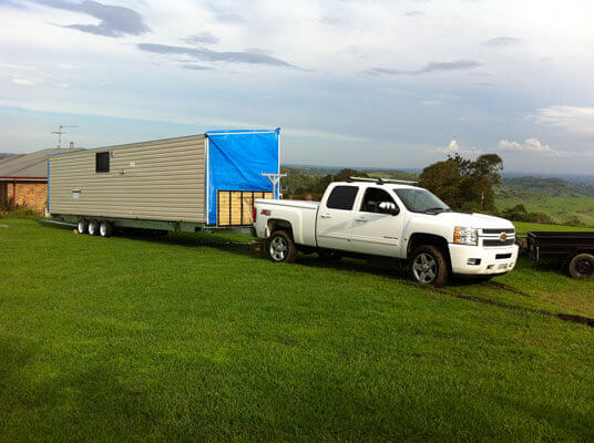 A relocatable cabin being transported to its new home in Sydney
