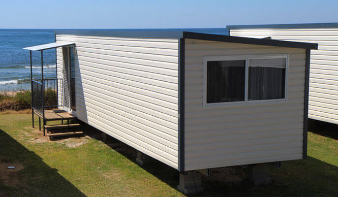 Relocatable cabin set up near a Sydney beach